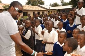 Chris Tucker with Tanzanian school children