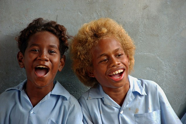 SOLOMON ISLANDS. Melanesian boyfriends wearing light blue shirts