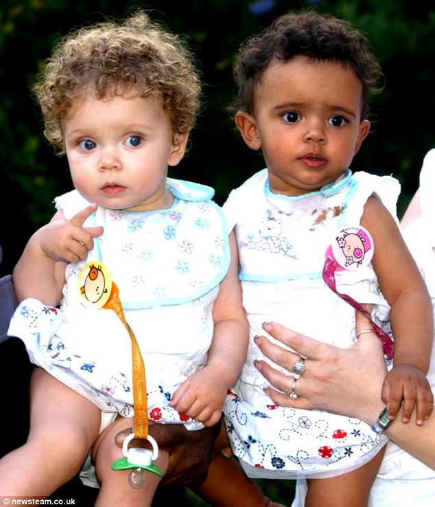 Mixed couple with black and white twins