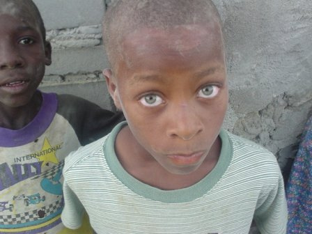 Angola children black green eyes