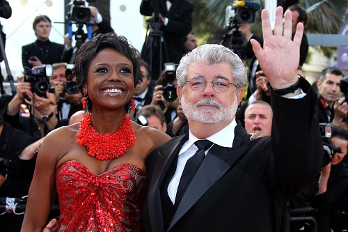 """US director George Lucas arrives with partner Mellody Hobson for the screening of """"Wall Street - Money Never Sleeps"""" presented out of competition at the 63rd Cannes Film Festival on May 14, 2010 in Cannes. AFP PHOTO / VALERY HACHE"""